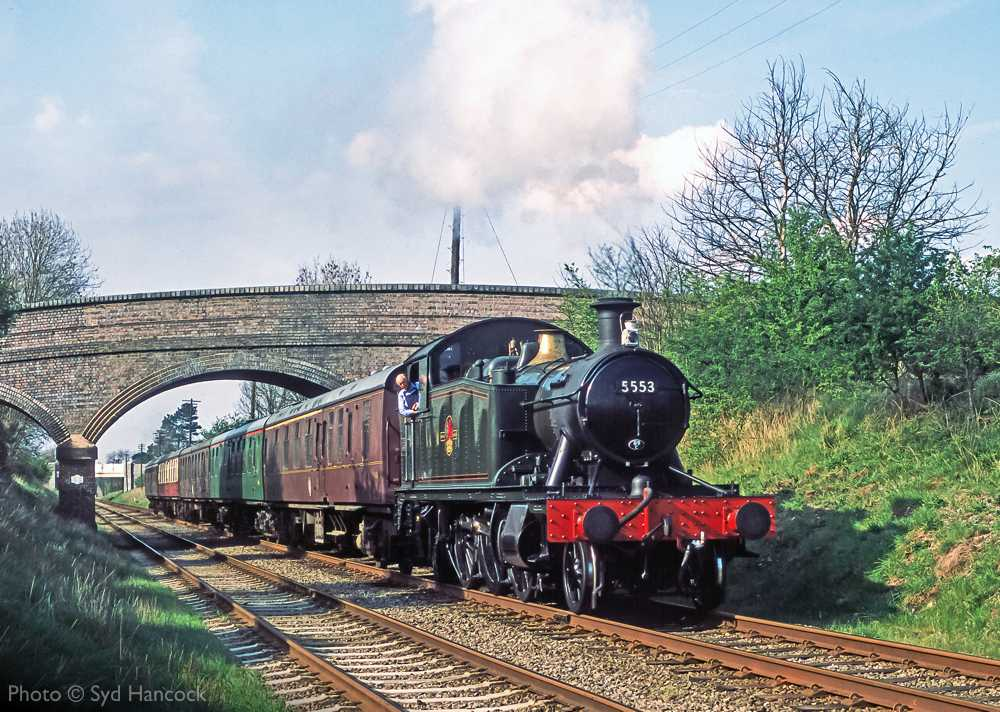 """""""An assortment of liveries is on display on this southbound passenger train, hauled towards Quorn & Woodhouse by GWR Small Prairie 5553, back in April 2004."""" - Photo © Syd Hancock."""