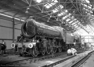 """Work in progress inside the recently constructed locomotive shed at Loughborough on 10th September 1978, with Thompson B1 1306 'Mayflower' and Manning Wardle 0-6-0 'Littleton No. 5'."" - Photo © Harper Shaw Collection."