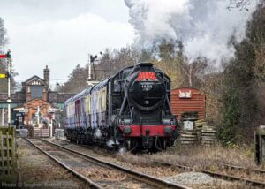 """""""Stanier Class 8 48305 hauls Santa's special train away from Quorn & Woodhouse in December 2020."""" - Photo © Stephen Bottrill."""