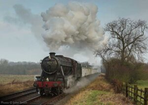 """""""Recreating the experience... Stanier Class 8 48624 powers away from Loughborough with a mineral train at a GCR steam gala."""" - Photo © John Smith."""