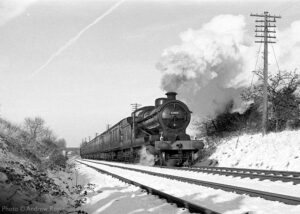 """""""Continuing the winter theme, O4 63601 creates an excellent atmosphere while working a southbound passenger train in December 2000."""" The overhaul of 63601 is currently in progress, and this popular locomotive will return to steam at the Great Central Railway. 63601 appears courtesy of the National Railway Museum. - Photo © Andrew Royle."""