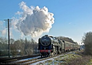 """""""Making light work of a northbound passenger train, 70013 'Oliver Cromwell' steams towards Loughborough on a bright winter afternoon."""" 70013 appears courtesy of the National Railway Museum and is currently under overhaul at Loughborough, prior to returning to steam here at the GCR. - Photo © Stephen Bottrill."""