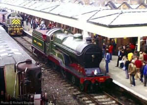 """""""Great Central Railway 11F or Improved Director Class number 506 """"Butler Henderson"""" stands at Loughborough Central, in a busy scene from the early 1980s"""". 506 appears courtesy of the National Railway Museum. - Photo © Richard Bingham."""