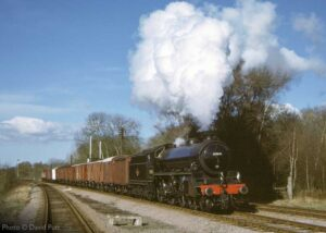 """""""Back in 2004, before the commissioning of signalling at Swithland Sidings, Thompson B1 61264 is pictured hauling a southbound van train"""". - Photo © David Putt."""