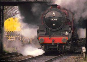 """Railways at work... Visiting Hughes 'Crab' 13065 hauls a coal train away from Loughborough Central"". - Photo © Ken Simms."