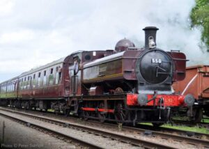 """""""Ex-GWR pannier tank 5786, appearing in London Transport livery and with later number L92, makes good progress with a southbound passenger train during a visit to the GCR in 2014"""". - Photo © Peter Salmon."""