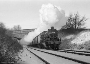 """""""Recreating a image of days gone by... Thompson B1 61264 steams through a cutting between Loughborough Central and Quorn & Woodhouse in the winter of 2000, in a scene which could easily be mistaken for over 40 years earlier"""". - Photo © Andrew Royle."""