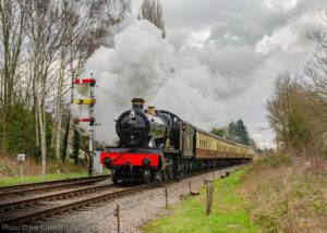 """""""A nod to the Great Western Railway, as visiting Hall Class 4953 'Pitchford Hall' accelerates away from Rothley with a northbound passenger train, passing three of the lower quadrant signals at Swithland Sidings which would also be very familiar in Great Western territory"""". - Photo © Joe Connell."""