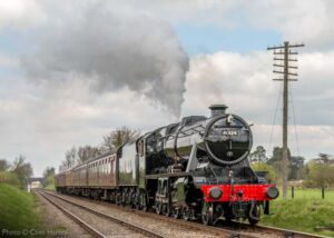 """""""A dependable performer... Stanier Class 8 48624 steams south from Loughborough Central with a passenger train for Leicester North in April 2015, with paintwork gleaming in the afternoon sunshine"""". - Photo © Clive Hanley."""