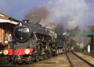 """""""Class 5 steam locos make an impressive entrance... Stanier Class 5 45305 and British Railways Standard Class 5 73156 arrive at Quorn & Woodhouse station."""" - Photo © Ken Simms."""