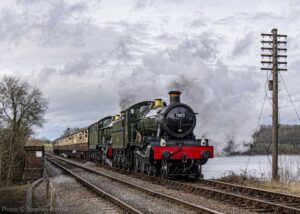 """""""A Great Western theme is very much in evidence as visiting Manor Class 7802 'Bradley Manor' pilots Modified Hall Class 6990 'Witherslack Hall' across Swithland Viaduct in January 2019"""". - Photo © Stephen Bottrill."""