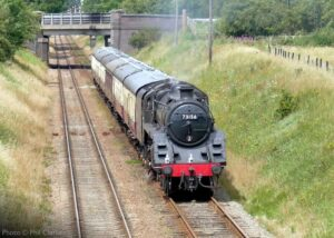 """""""Steam in motion on a summer afternoon... British Railways Standard Class 5 4-6-0 73156 works empty coaching stock away from Loughborough Central during July 2020"""". - Photo © Phil Clarke."""