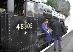 """""""A short break for the footplate crew of Stanier Class 8 48305, as the loco waits for the next duty at Loughborough Central."""" - Photo © Peter Salmon."""