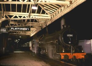 """""""A timeless scene is created at Loughborough Central as Thompson B1 61264 stands in Platform 1 in January 2001."""" - Photo © Ian Duffield"""