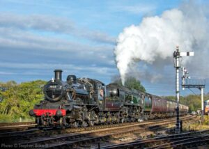 """""""Looking back to October 2017, British Railways Standard Class 2 78018 and Southern Railway Battle of Britain Class 34053 'Sir Keith Park' work a passenger train past Swithland Sidings."""" - Photo © Stephen Bottrill."""