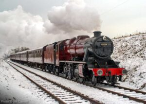 """""""On this weekend nine years ago, snow was once again a feature as Stanier Class 8 48624 steams southwards."""" - Photo © Joe Connell."""