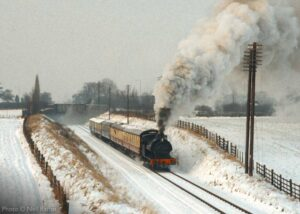 """""""Early days... In 1984, before the reinstatement of double-track, Robert Nelson Number 4 steams through the snow-covered landscape south of Loughborough Central."""" - Photo © Neil Raffan."""