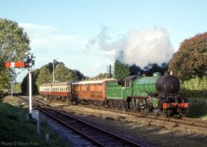 """""""A London and North Eastern Railway theme is formed by D49 4-4-0 number 246 'Morayshire', hauling LNER pigeon van 4050, and two later British Railways Mark 1 coaches, on the northern approaches to Quorn & Woodhouse"""". - Photo © David Putt."""