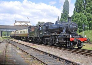"""""""On a bright afternoon in the summer of 2014, Ivatt Class 2 46521 steams away from Loughborough Central with the lunchtime dining train."""" - Photo © Peter Salmon."""