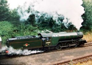 """""""Gresley's V2 locomotives were once a common sight on the former Great Central main line between London Marylebone and Sheffield. Sole-surviving V2 'Green Arrow' is seen here carrying British Railways number 60800 at Rothley around 2001."""" """"Green Arrow"""" appears courtesy of the National Railway Museum. - Photo © Richard Bingham."""