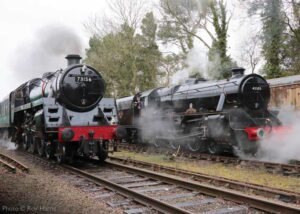 """""""Class 5 evolution... British Railways Standard Class 5 73156 of 1956 and Stanier Class 5 45305 of 1936 pass at Rothley, one year ago at our 2020 Winter Steam Gala."""" Although the Winter Steam Gala is unavoidably absent from the calendar in January 2021, the event will return in better times! - Photo © Roy Harris."""