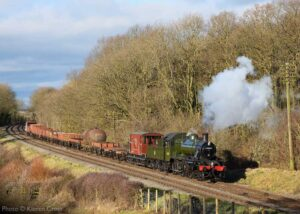 """""""A mixed goods train often appears as part of our Winter Steam Galas. Ivatt Class 2 46521 is seen here in a picturesque scene from 2018's event"""". - Photo © Kieren Cross."""