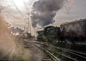 """""""Passing trains on the Great Central Railway... Southern Railway King Arthur Class 777 'Sir Lamiel' passes Great Western Railway Modified Hall 6990 """"Witherslack Hall"""" on the main lines at Swithland Sidings"""". 777 'Sir Lamiel' appears courtesy of the National Railway Museum. - Photo © Stephen Bottrill."""