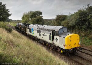 """""""Heritage locomotives of many shapes and sizes... Steam loco British Railways Standard Class 5 73156 and diesel loco 37714 were originally built only five years apart, in 1956 and 1961 respectively"""". 37714 originally entered service as English Electric Type 3 D6724, and now appears as it did in the 1990s in the Trainload Metals sector livery of British Rail. - Photo © John Smith."""